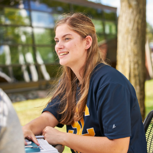 Student sitting outdoors