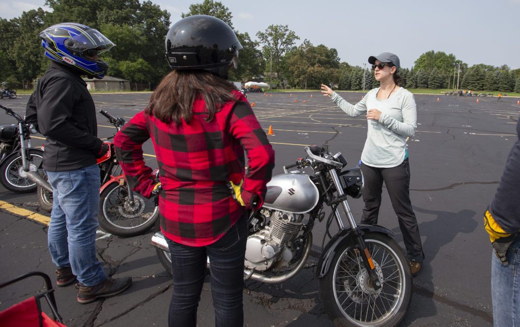 Motorcyclists listening to instruction