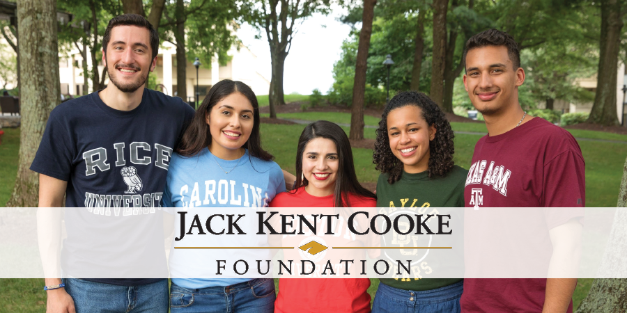 """Five people standing in a row with a banner that reads """"Jack Kent Cooke Foundation"""""""
